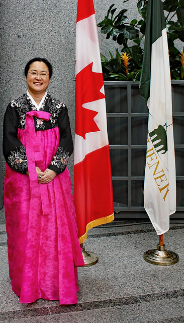 Jennifer in traditional dress with cdn flag